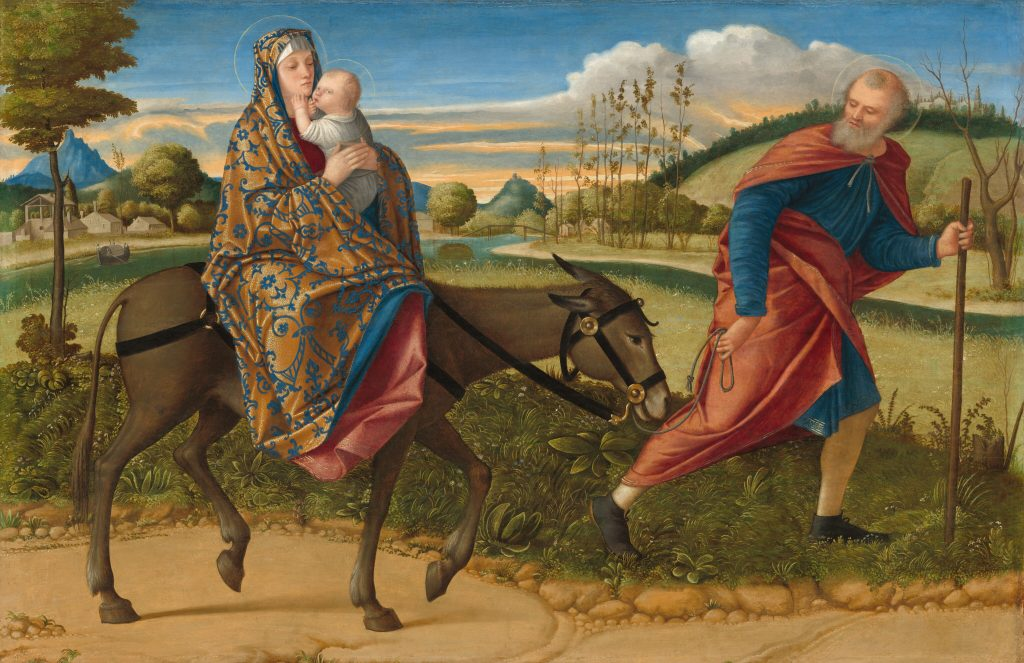 Painting of Mary and infant Jesus riding a donkey through a landscape. Joseph walks in front of them.