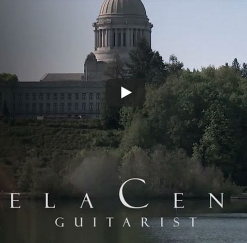 YouTube screenshot showing domed building behind white type reading Angela Centola guitarist